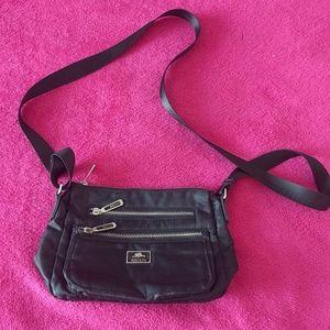 Beautiful  black crossbody bag by Roots🍀